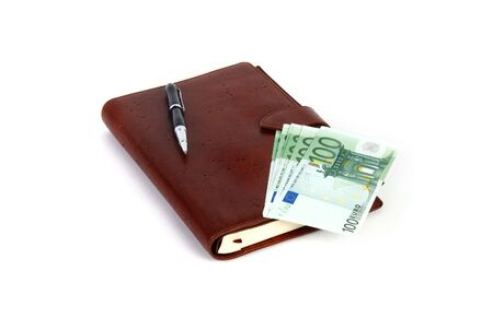 personal organizer with pen and euros photo