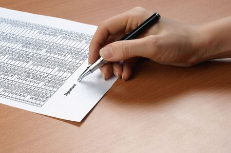 hand with black pen sign the document Stock Photo - 5917406