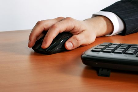 hand on keyboard or with mouse Stock Photo - 5990038