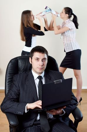 businessman with laptop sit in an armchair with collgues on backside Stock Photo - 6038069