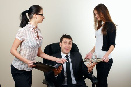businessman  sit in an armchair with collgues on backside Stock Photo - 6104410