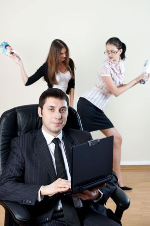 businessman with laptop sit in an armchair with collgues on backside Stock Photo - 6104396