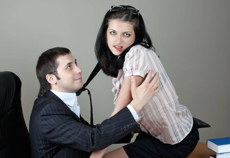 businessman with beauty secretary in office photo