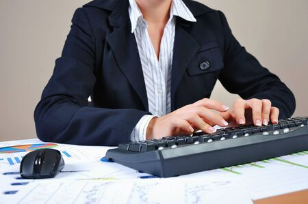 Hands of a young woman presses the keyboard  Workplace businessman photo