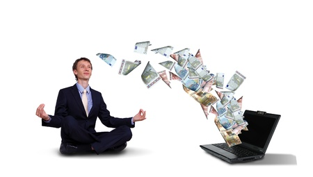 Young businessman with banknotes all around him photo