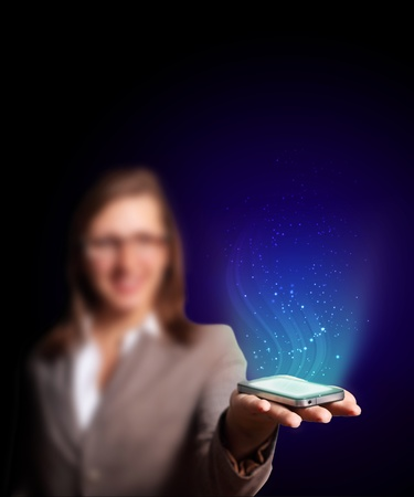Business woman holding a mobile phone sending images photo
