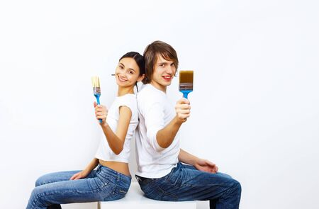 Young couple with paint brushes doing renovation together Stock Photo - 11794164