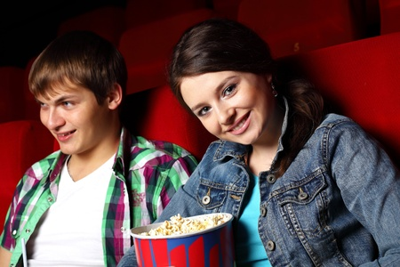 Young couple sitting in cinema and watching movie Stock Photo - 11793759