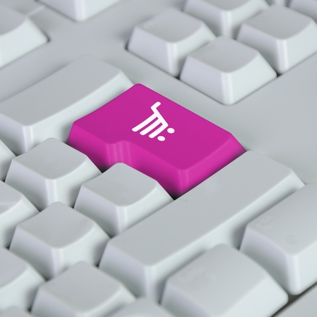 Computer keyboard with on-line shopping symbol on it Stock Photo - 11793898