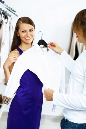 Young caucausian couple doing clothing shopping together photo