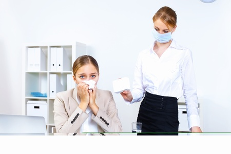 Young woman feeling unwell and sick in office Stock Photo - 11844263