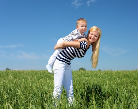 mother with her son outdoor in sunny summer day photo