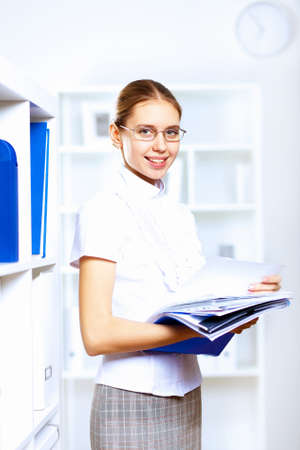 graduation suit: Young blond woman in business wear in office environment Stock Photo