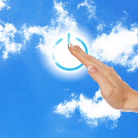 Picture of power button against blue sky background photo