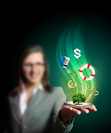 Business woman holding a mobile phone sending images Stock Photo - 11846817
