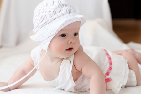 portrait of cute little baby in a funny hat photo