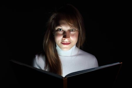 Collage of a young woman reading a magic book Stock Photo - 11907869