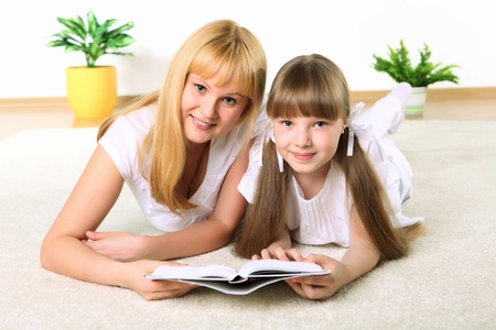 portrait of mother together with daughter with book in studio Stock Photo - 11907858