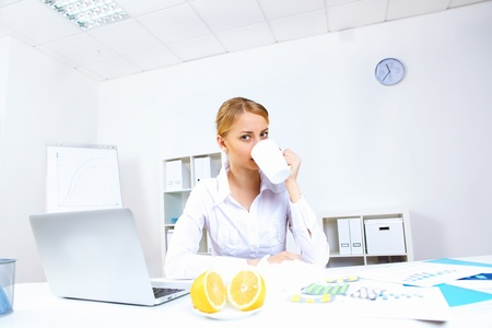 Young woman feeling unwell and sick in office Stock Photo - 11907971
