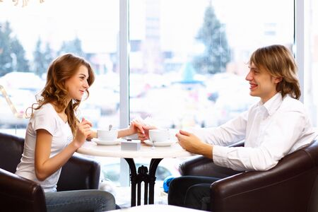 Young couple in love having a date in restaurant photo
