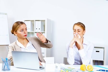 Young woman feeling unwell and sick in office Stock Photo - 11907934