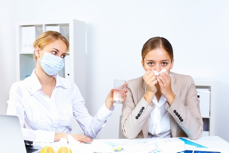 Young woman feeling unwell and sick in office Stock Photo - 11907916