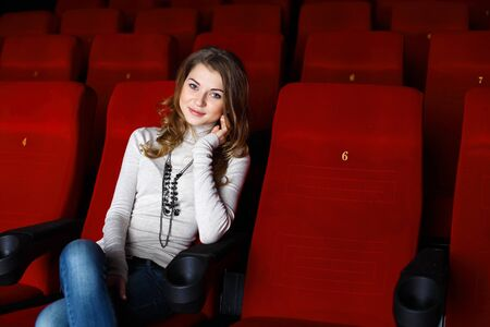 Young girl sitting in cinema and watching movie Stock Photo - 11989084