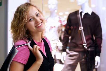 choosing clothes: Young woman doing shopping and choosing clothes