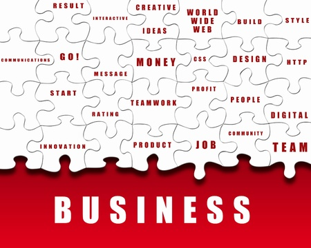 Puzzle pieces with business terms written on them photo