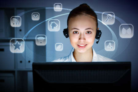 Young woman in business wear in headset working with computer Stock Photo - 11989239