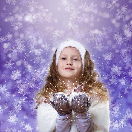 Cuty little girl in winter wear happy about new year photo