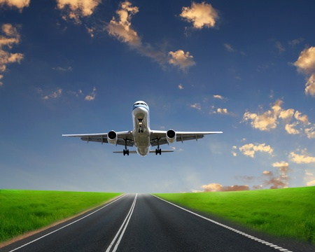 Image of plane on blue sky background photo