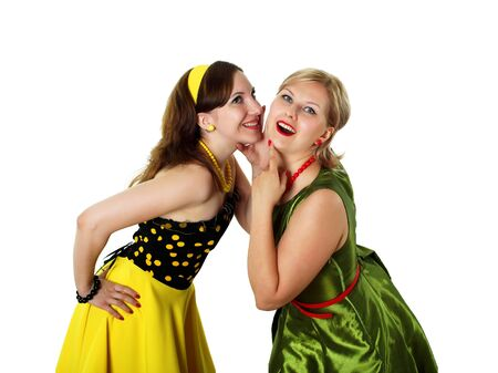 two stylish young woman in bright colour dresses photo