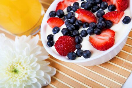 Early breakfast. Strawberries, cream and juice. The symbol of healthy lifestyles. Stock Photo - 11988857