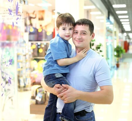 Father and his little child doing shopping photo