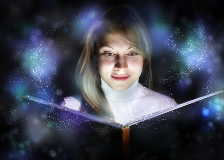 Collage of a young woman reading a magic book Stock Photo - 11988840
