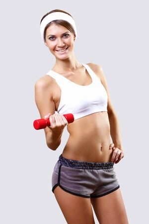 Young pretty woman in sport wear doing sport Stock Photo - 11988422