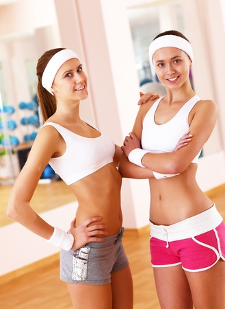 Young woman in sport wear doing sport in gym Stock Photo - 11988850