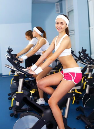 Young woman in sport wear doing sport in gym Stock Photo - 11988740