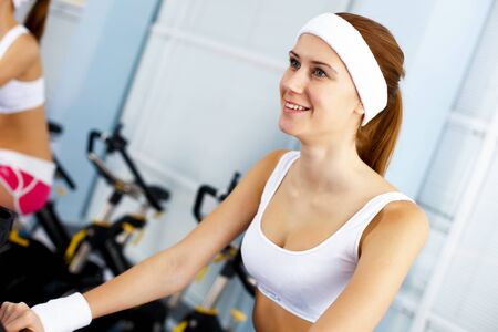 Young woman in sport wear doing sport in gym Stock Photo - 11988537