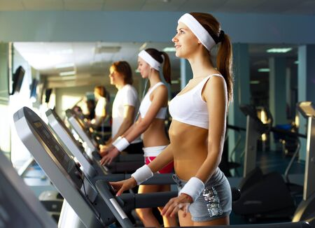 Young woman in sport wear doing sport in gym Stock Photo - 11988846