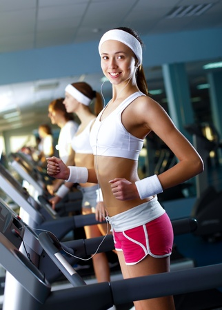 Young woman in sport wear doing sport in gym Stock Photo - 11988825