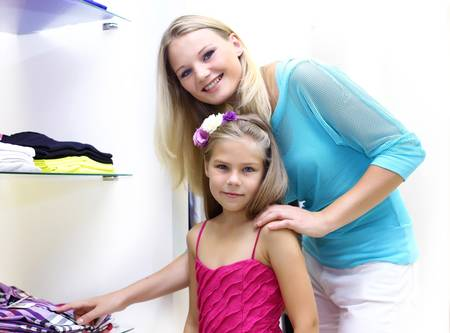 Young mother and her daughter doing shopping together photo