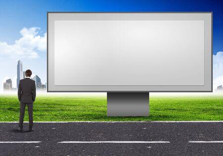 blank billboard: Business person stand in der N�he einer blank billboard Lizenzfreie Bilder