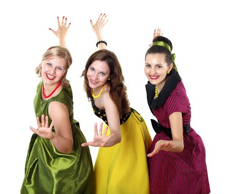 three stylish young woman in bright colour dresses photo