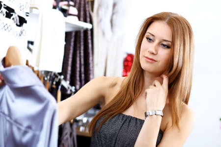 Portrait of young woman inside a store buying clothes  photo