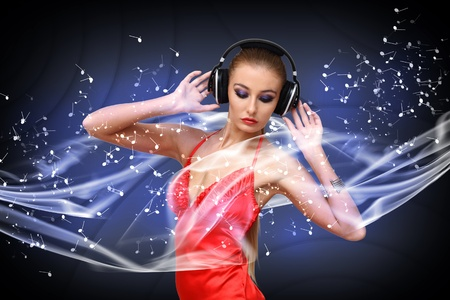earphone: Portrait of young woman in evening dress with headphones