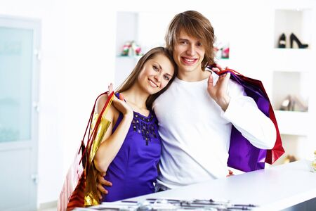 Young caucausian couple with bags doing shopping together Stock Photo - 12403733