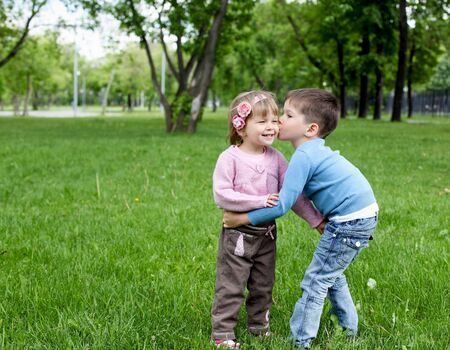 happy sister and brother together in the park photo