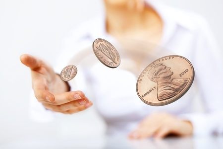 coin toss: Person throwing a coin as symbol of risk and luck Stock Photo